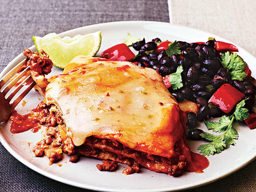 Make a hearty, healthy Mexican casserole the whole family will enjoy. Substitute ground turkey and chicken broth instead of beef, if desired.