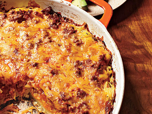 This simple skillet dish uses shredded potatoes as a base. The potato mixture cooks on the stove top first to get it browned and crisp on the bottom. Use a cast-iron skillet to get the potatoes perfectly crusted on the bottom, then bake them with smoky chorizo under a blanket of gooey cheese.