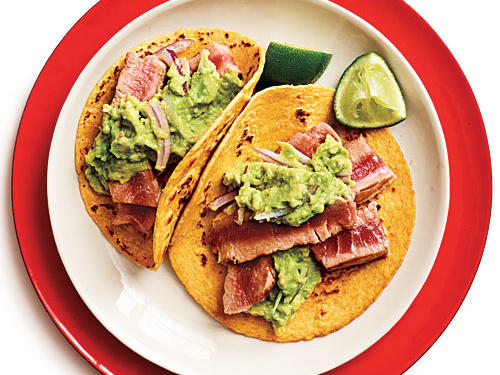 Brighten up weeknight dinners with easy and flavorful tuna tacos. The guacamole is very creamy and tasty on its own–make extra.