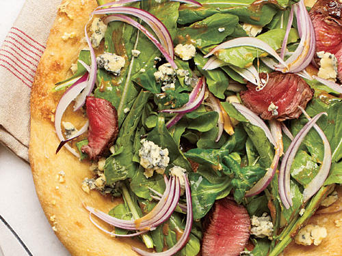 "Wider, less-lobed Eruca sativa varieties, which are more palatable in larger quantities when dressed simply, would be a great topping on this pizza. This is a new take on a ""steak and salad with a side of bread"" and a fun way to enjoy dinner in a bite."