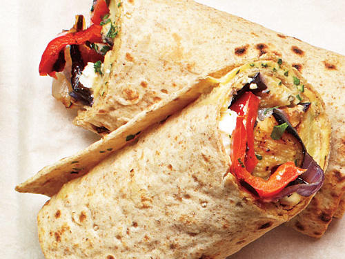 The sandwich has dominated the lunchbox scene for long enough. It's time to make some room in your weekly lunch routine for one of these riveting roll-ups.                                  Our first selection is a reader favorite— our Grilled Veggie and Hummus Wrap.                                  Make the most of your fresh vegetables by preparing these great wraps. Pair with a side of potato or pasta salad.