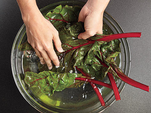 Wash leaves in a sink or large bowl of water until free of grit. Drain and pat dry.