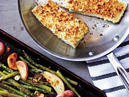 Fish is a great choice for quick dinners–most fillets cook to perfection in less than 10 minutes. You can use pecans, walnuts, or pine nuts in place of hazelnuts. To streamline prep, roast the asparagus together with the suggested potato side dish.