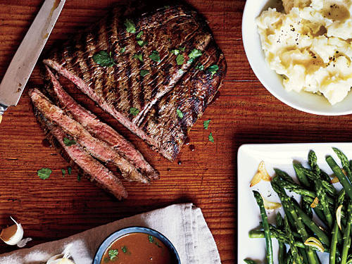 Perfectly seasoned flank steak is kicked up a notch with flavor-packing soy-mustard sauce. Serve with Garlicky Asparagus and Garlic Mashed Potatoes.