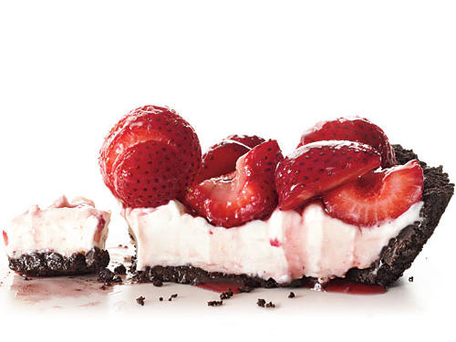 Glorious spring berries are the focus here—tons of them, piled atop a layer of creamy filling and a chocolate wafer cookie crust.