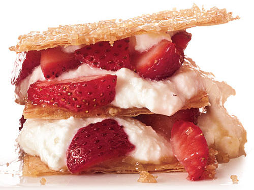 Crisp sheets of sugared phyllo, creamy ricotta and honey, and showstopping strawberries combine to create a delightful dessert that everyone will be sure to love. Seconds, please!