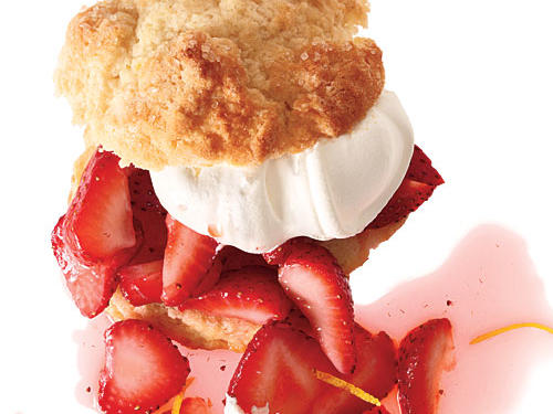 Tender biscuits get a little lift from sweet, floral lemon rind. For slightly taller shortcakes with soft sides, pack biscuits into a round cake pan; for separate shortcakes with crisp edges, arrange onto a baking sheet with space between.