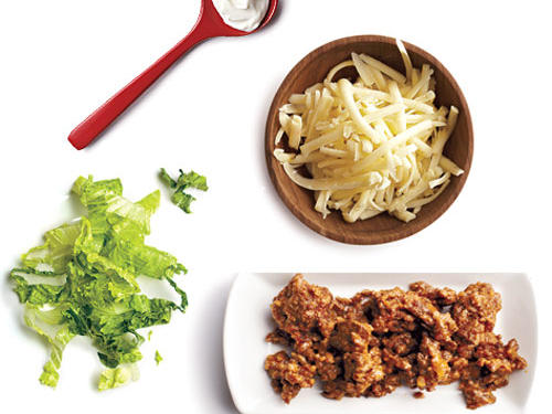 1 tablespoon light sour cream + 1 tablespoon Monterey Jack cheese + ¼ cup shredded lettuce + 1.5 ounces seasoned lean ground beef