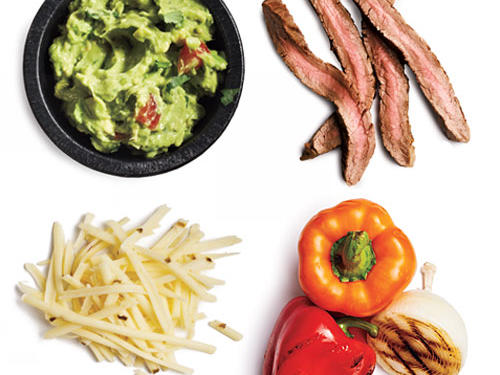 1.5 ounces grilled flank steak + 1 tablespoon guacamole + 1 tablespoon pepper Jack cheese + ¼ cup grilled peppers and onions