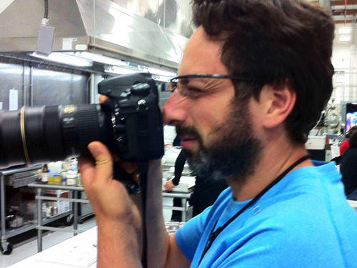 "Google co-founder Sergey Brin, one of the guests (wearing ""Google glasses"") shoots the goat-shake volcano."