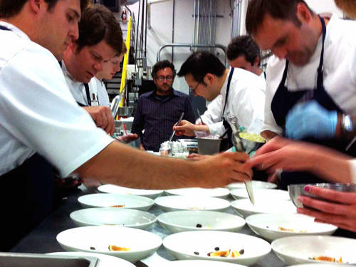 "Brigade of cooks uses chopsticks to assemble fruit for the ""minestrone"" dessert Course."
