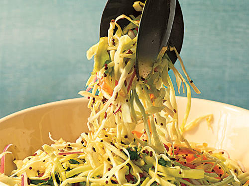 Mustard seed, cilantro, and cumin give this coleslaw an Indian spin.