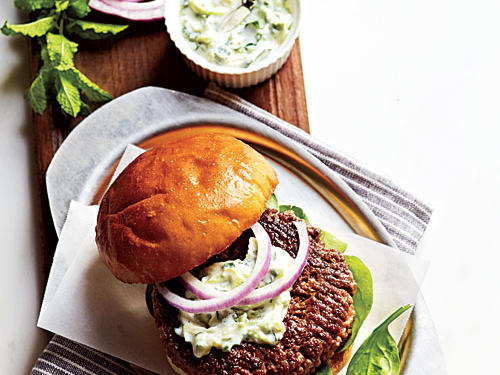The tangy, herby yogurt sauce (raita) stands in for mayonnaise on this blended burger. For more spicy kick, leave the seeds in the serrano chile.