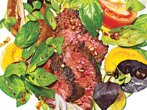 If regular Italian—or Genovese—basil is all you can find, it'll work fine. However, it's worth searching out a few varieties, such as purple, Thai, or lemon basil. Using a mix of varieties improves the salad by adding visual interest and nuanced flavors. If you can't find hanger steak, substitute flank instead.