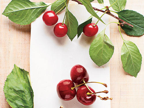 For a fleeting time, all those sweet cherries pile into roadside stands and farmers' markets. Some areas get them as early as May, but the rest of us have to wait until the heart of the season, from June to early August. What beautiful fruits they are—firm but surprisingly syrupy and juicy. Here we'll show you five cherry varieties as well as where we bought these bountiful beauties. Don't worry, we're also passing along a few scrumptious recipes, too.