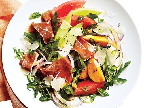 Salty cheese and ham accent the sweet summer fruit in this refreshing main-dish salad, a perfect meal on a sweltering summer day.