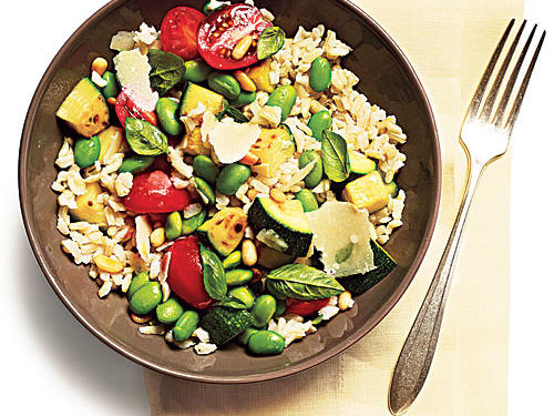 Fresh tomatoes, zucchini, basil, and toasted pine nuts bring this rice salad to life. Serve it with 1 pound roasted fresh green beans.