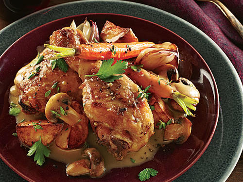 This is a riff on coq au vin, the French standard of chicken and veggies simmered in red wine. The coq usually takes on a deep purplish-red cast from the vin, but our modern take cooks the chicken in broth: It tastes lighter and looks much brighter. After the chicken cooks, it's smothered with a delicious Champagne reduction sauce that's enriched with nutty brown butter.