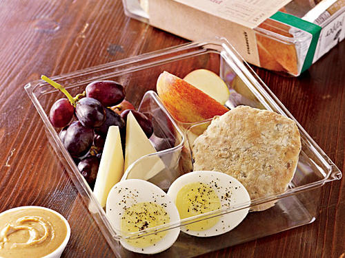 When it comes to breakfast on the run, it can be hard to find one with plenty of protein that's not also oozing with saturated fat. Enter Starbuck's Protein Bistro Box, an energizing combo of fruit, peanut butter, a hard cooked egg, and multigrain muesli bread. Together these deliver the perfect balance of protein, complex carbs and healthy fats to help you power through your morning. One serving provides 380 calories, 5 grams fiber, 19 g fat and 13 g protein. Pair it with a cup of green tea for an added antioxidant boost.