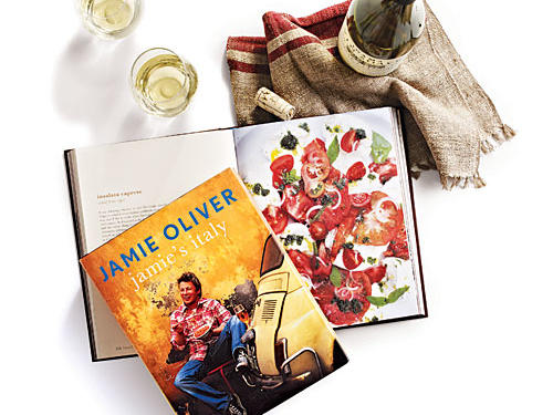 "Jamie's Italy By Jamie Oliver, Hyperion, 2006. Hardcover. $35; 319 pagesAmiable Brit Chef Jamie Oliver peeks into everyday Italian households where food remains so central to family. He tours the country, introducing us to home cooks, farmers, and producers whose stories captivated and inspired him to create this book. His conversational writing makes you feel like you're along for the ride—and what a ride it is. ""I want you to experience [the spirit of Italy],"" Oliver writes. ""I want you to walk past the wall of footballing posters in Palermo and chuckle because you've seen it here. I want you to go and find the old woman making polenta in the town of Bari in Puglia ... I want you to go and see Dario the butcher in Panzano in Chianti and shake his hand.""GIVE THIS TO: Jamie fans who want a taste of Italian. —Deb Wise"