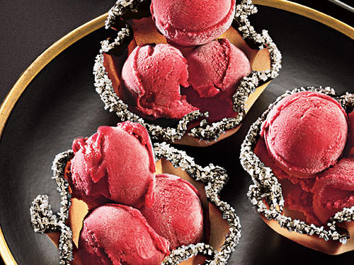 Whimsical cookie cups bedazzled with sugar crystals add sparkle to your holiday table. The bracingly tart cranberry sherbet lends a pop of garnet color.