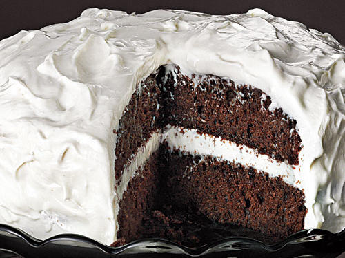 Marshmallow creme mixed with cream cheese, powdered sugar, and vanilla creates a light and fluffy filling for this layered cake.