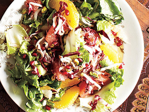 This bright, fresh salad of winter greens and sweet-tangy citrus is studded with red pomegranate arils: It's a dramatic, holiday-worthy plate and a welcome course for vegetarians.