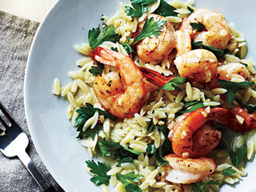 Indulge in the flavor of the Mediterranean with plump shrimp tossed with lemon and pepper. Serve over parsley orzo with sautéed asparagus for a fine accompaniment and complete dish.