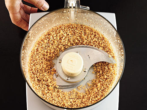 How we make our crust healthy, tasty, and beautifulPulse the walnuts until finely ground but not pasty. The nuts will release their good-for-you oils when ground, reducing the need for extra butter.