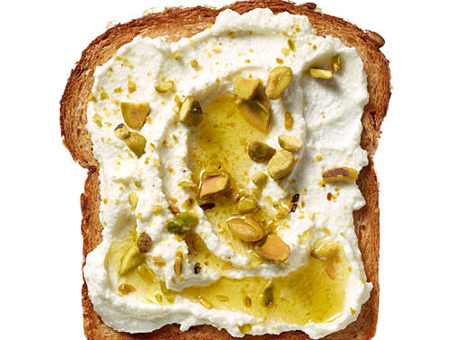 Put a new twist on a breakfast standby with Ricotta-Pistachio Toast: Spread 2 tablespoons light ricotta cheese (we love Calabro's part-skim) on crusty whole-grain bread. Drizzle 1 teaspoon olive oil over ricotta. Sprinkle with 1 tablespoon crushed, dry-roasted, salted pistachios. Find more 200-Calorie Ideas for Toast here.
