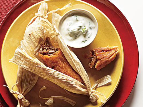 Known for their rich filling of meats, cheeses, veggies and chiles, tamales have long-since been a staple in Spanish and Mexican culinary culture. Don't let their long history intimidate you, though–these healthy tamale recipes require patience and time but are well-worth the effort in the kitchen. First up are our Chipotle Pork Tamales with Cilantro-Lime Crema. These authentic pork tamales are bursting with flavor and serve as a wonderful gift for loved ones. For gift giving, assemble and steam tamales. Cool and freeze, wrapped in husks, in an airtight container, and attach a note about reheating.