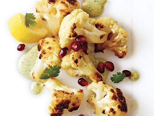 Cilantro gives this a bright, zippy taste and lovely color; the leaves are especially festive when strewn with pomegranate arils over the cauliflower. Serve with hot sauce and cut lemons, if you wish.