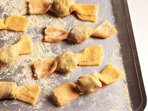 Arrange pasta on a baking sheet dusted with semolina to prevent sticking.