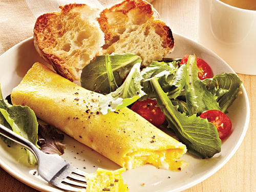Our Classic French Omelet is the perfect way to start off any morning. The trick to mastering the French omelet is to pull the pan off the heat as needed, while stirring, to control how fast the eggs cook. The finished omelet should be golden outside and unbrowned, while still creamy at the very center.