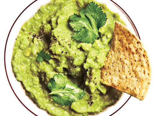 There's no credible way to lighten guacamole since the main ingredient–avocado–is high in fat. But it's heart-healthy and a worth-while splurge occasionally!
