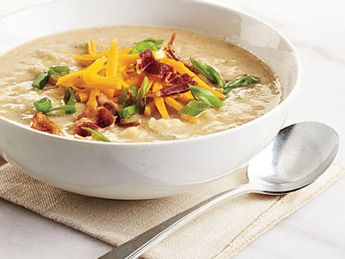 The irresistible trifecta of starchy, creamy, and comforting pleasures found in loaded potato soup makes this warming bowl a restaurant and home-cooked favorite, especially on chilly, wintry days. Because cauliflower has two-thirds fewer calories per ounce than the starchy potato, swapping some in is both wise and tasty.