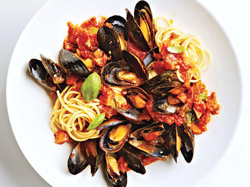 You will love mussels in this slow-cooked red sauce. The red wine and basil make the sauce ultra luxurious – the perfect thing to accompany delicate mussels. Serve over pasta, with a glass of vino rosso (red wine) for a lush and tasty meal.