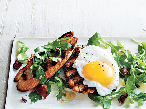 In this Poached Egg and Arugula Salad Bruschetta dish, top toasts with bacon-y arugula salad, or break the egg and let the golden yolk run over all. For a simple side, riff on hash brown potatoes by tossing refrigerated potato wedges with olive oil, salt, and pepper.