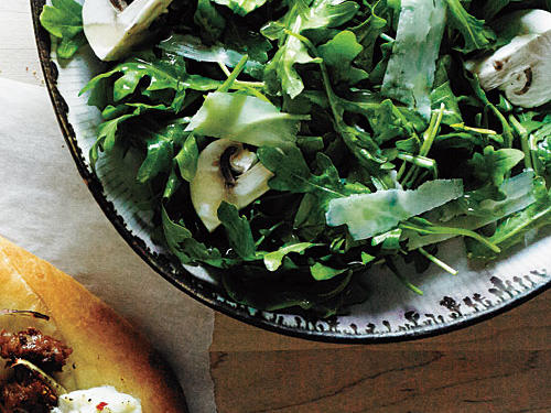 A lemon vinaigrette lightly coats Arugula and Mushroom Salad. Make this side salad to complement your favorite pizza.