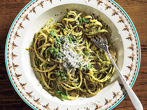 Here is a lovely twist on beloved pesto for spring. Baby spinach takes the place of most of the basil to give the sauce an earthy flavor. The thick, emerald sauce beautifully coats the flat noodles and serves up big flavor in every forkful.
