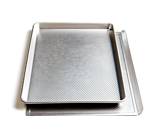 A baking sheet (bottom) is flat, usually with a raised lip on one side; it allows even heat distribution for baking cookies. The sides of a jelly-roll pan corral juices from foods that let off liquid, and they help keep things like oven fries from flying off the pan when you stir them.—Ann Taylor Pittman, Executive Editor, Food