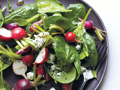 To crumble the goat cheese over this scrumptious spring salad, freeze it for 10 minutes, and then flake with a fork.