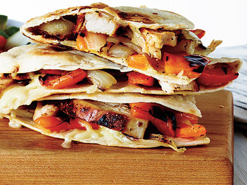 A rich mixture of Monterey Jack cheese, grilled chicken, and fresh veggies will make these quesadillas a hit with everyone in the family.