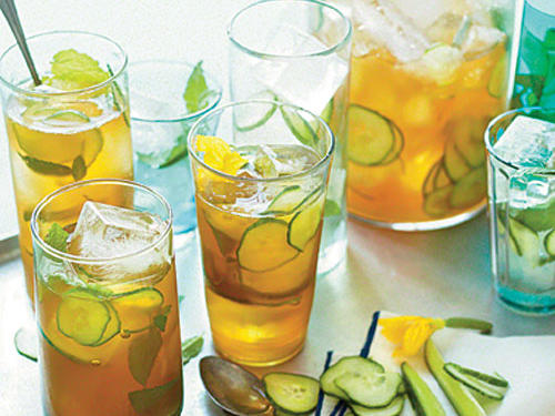 A traditional Pimm's Cup may include slices of lemon and orange, mint, and sometimes rosemary or thyme, along with cucumber spears. We steeped the lemonade overnight with cucumber slices to bring out their flavor.