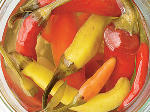 Chop and sprinkle these pickled peppers over salads or on sandwiches. Use the vinegar mixture to kick up salad dressing.