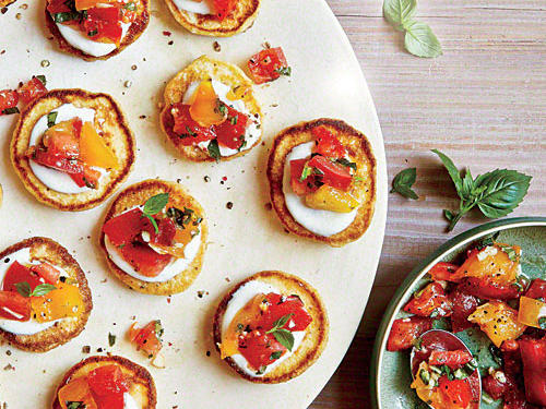 With tomatoes fresh from the garden, these mini cornmeal cake appetizer treats encompass the full flavors of the season's best produce.
