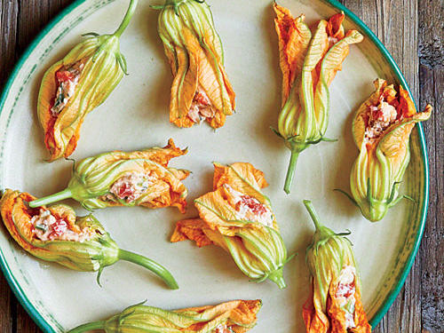 Fresh squash blossoms are a lovely seasonal treat. Enjoy the contrast of crisp, fresh flowers with rich, creamy cheese spread. Be sure to use the best bacon you can find–brands that smoke with real wood offer the best flavor. And roast your own pepper; jarred versions may taste tinny. Use plain cheddar cheese for a mild flavor, or choose extra-sharp for more tang.