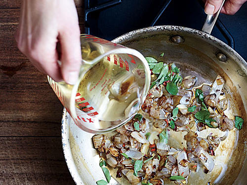 Sauté aromatics, and add wine or stock for flavor-filled poaching liquid.