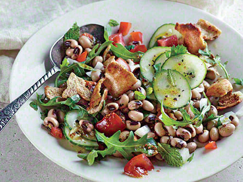 The ubiquitous Israeli bread salad makes a fine gathering place for black-eyed peas and sweet Georgia onions.