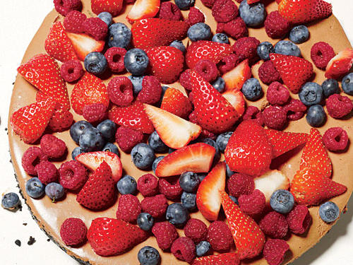 Raspberries, strawberries, and blueberries create a beautiful, sweet and tart finish to this chocolaty no-bake cheesecake.